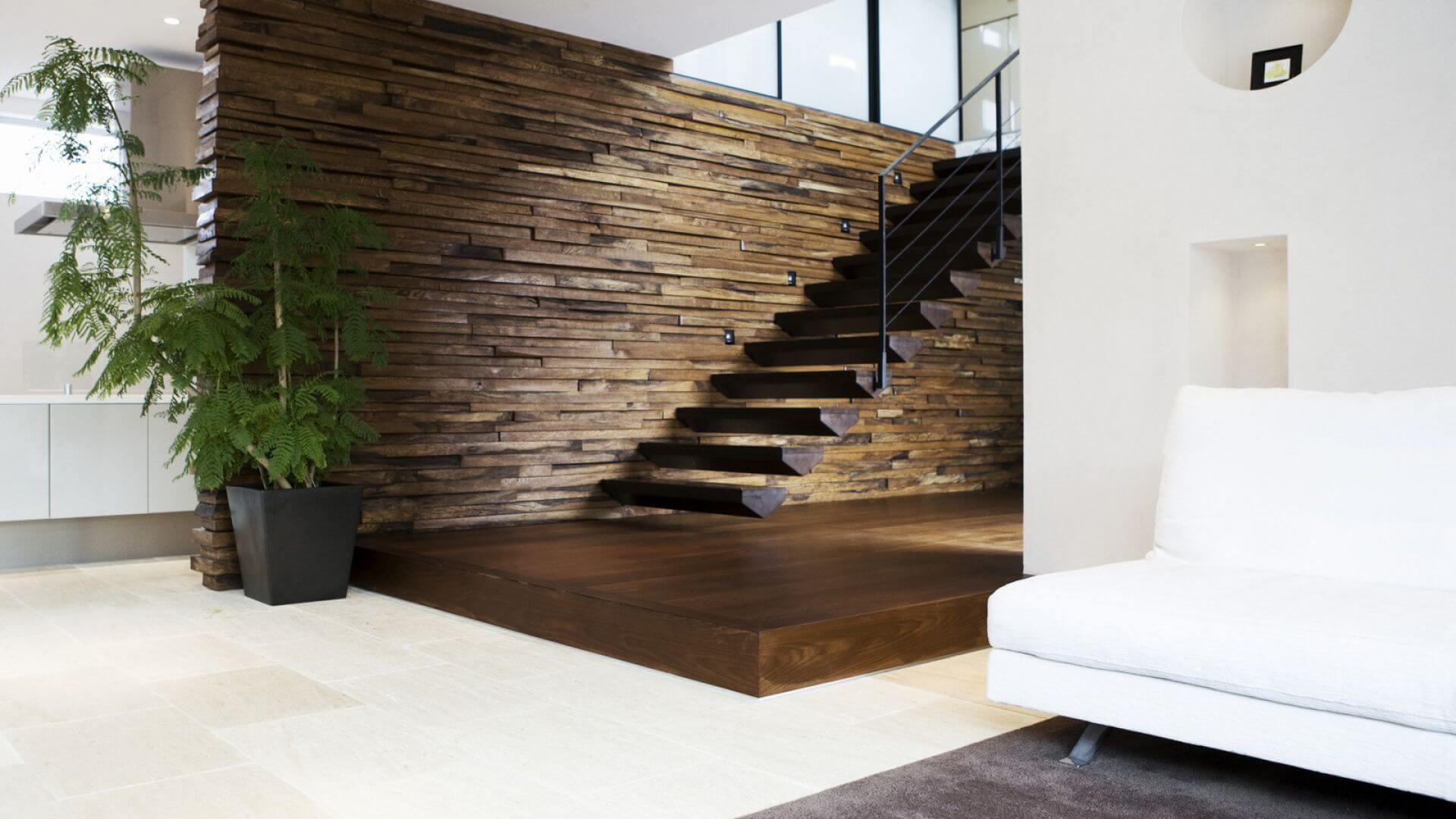 wood flooring with stairs and wall