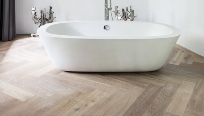 Herringbone pattern wood floor in the bathroom