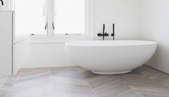 Chevron Pattern Wood Floor in the Bathroom
