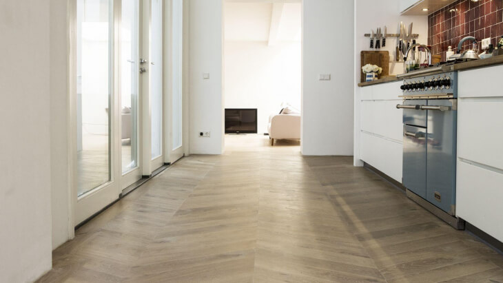 chevron pattern wooden floor with underfloor heating the hague