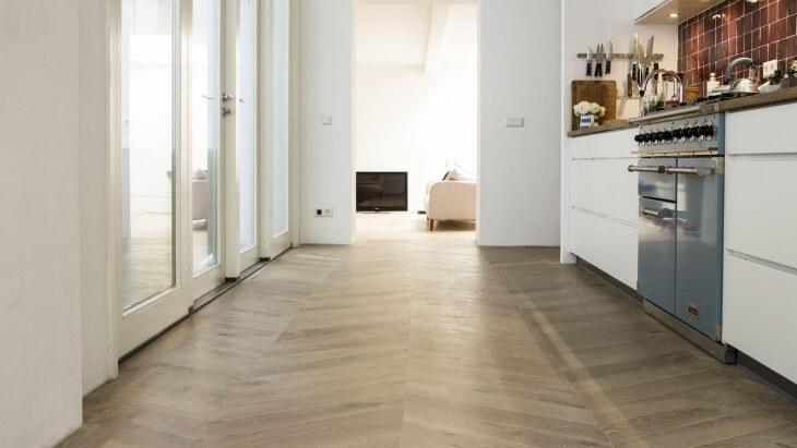 chevron pattern wooden floor with underfloor heating the hague